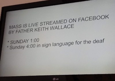 "A screen shot of a notice saying ""Mass is live streamed on Facebook by Father Keith Wallace: - Sunday 1:00, Sunday 4:00 in sign language for the deaf."""
