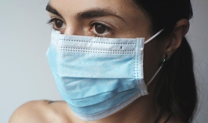 Woman wearing a cloth face mask