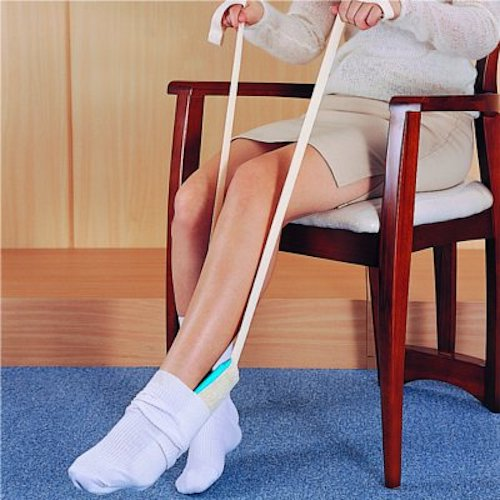 Buckingham delux sock aid being used by a woman sat on a chair