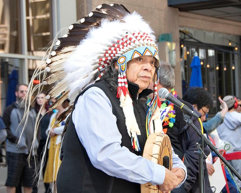 Elder in front of microphone