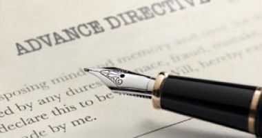 paper titled advance directives with pen on top of it