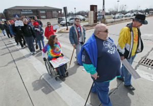 protesters march against discriminatory changes to bus stops