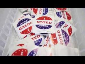 basket of stickers that say I Voted