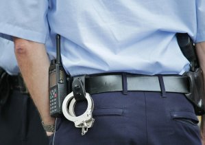 Belt of police officer with handcuffs hanging off