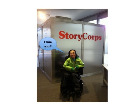 "Asian American woman in a wheelchair in front of a StoryCorps recording booth. A blue caption bubble says, ""Thank you!"""