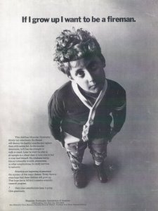 "Black and white photo of an ad featuring Ben Mattlin as a young boy for the Muscular Dystrophy Foundation. He is looking pensively at the camera and is about 7-8 years old. The text at the top of the image says, ""If I grow up I want to be a fireman."""