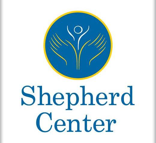 Logo of the Shepherd Center. A blue circle with yellow hands with a white figure in the middle. The words in blue text against white background says, Shepherd Center