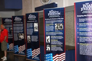 Exhibit posters that read: The Road to Freedom with photos from the disability rights movement.