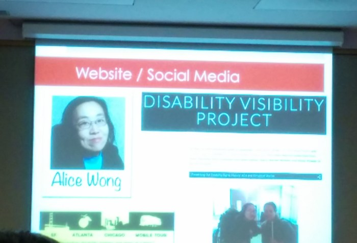 Image of a projection screen that features a screenshot of the Disability Visibility Project website. On the upper left hand corner is a photo of an Asian American woman in glasses.