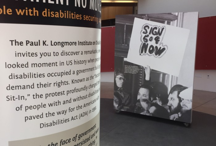 "Two posters, on the left is a poster that says, ""Patient No More"" and then smaller text describing the exhibit. On the right is a black and white photo of people crowded in front of a building with one sign that says: ""Sign 504 now"""