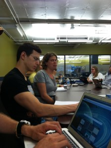 Image of Itai Dagan of Tikkun Olam Makers and Erin Lauridsen, Assistive Technology Educator, ILRCSF at a table during the meeting.