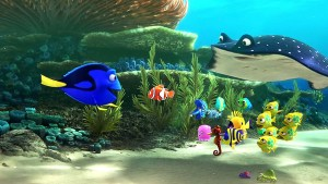 """An animated scene from the Pixar film """"Finding Dory."""" A coral reef with a blue tang fish talking to several smaller sea creatures and a manta ray"""
