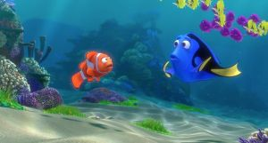 "An animated scene from the Pixar film ""Finding Dory."" Underwater scene where a clownfish is talking to a blue tang. The blue tang looks confused."