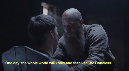 """Image description: screenshot from an episode of Vikings, an original series on the History Channel. Ivar the Boneless is sitting in a wooden chair facing his father, Ragnar Lothbrok. There are the following words in yellow script at the bottom: """"One day, the whole world will know and fear Ivar The Boneless."""" Source: https://maisumleitor.com/2016/05/27/ivar-ragnarsson-guerreirosvikings/"""