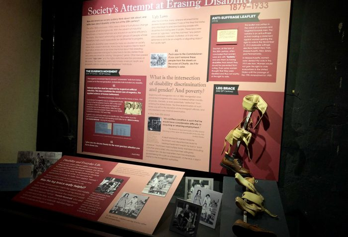 "Museum exhibit on disability showing a leg brace and photos with the with the title ""Society's Attempt at Erasing Disability."" Photo courtesy of Gann Academy. Photo credit: Maya Wainhaus"