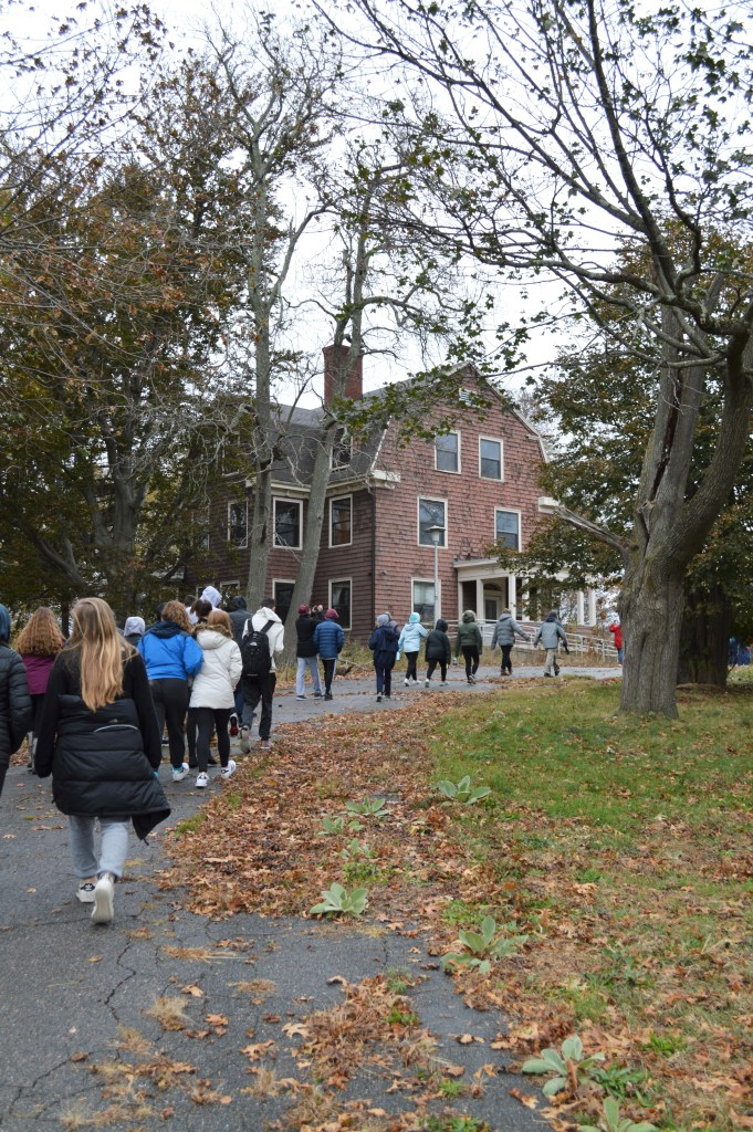 A group of students head toward the Superintendent's House, now abandoned, at the former Walter E. Fernald Developmental Center. Photo courtesy of Gann Academy. Photo credit: Maya Wainhaus