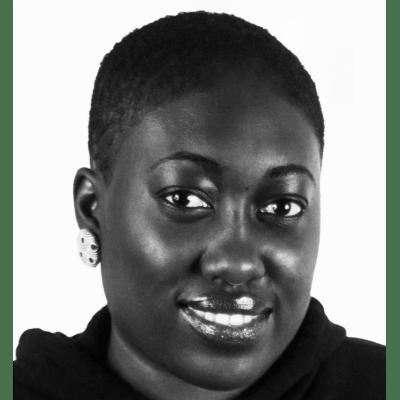 Imade Nibokun, a Black woman with short hair smiling