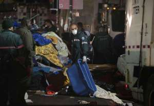 """Original photo and caption from the LA Times coverage of the settlement: """"New York sanitation workers remove debris and belongings left by protesters of Occupy Wall Street from Zuccotti Park during a nighttime raid on Nov. 15, 2011. (Carolyn Cole / Los Angeles Times / November 15, 2011)"""""""