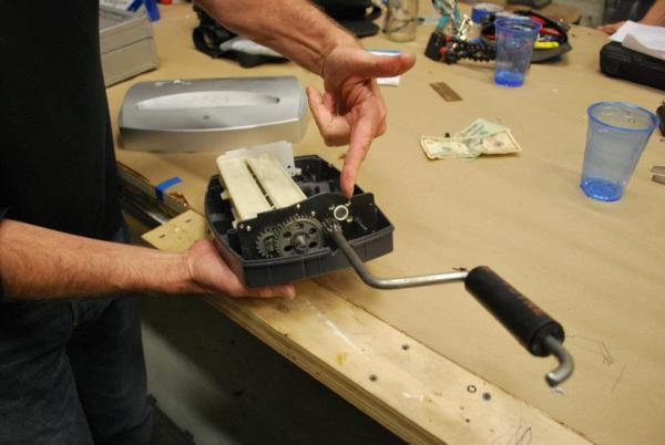 A present day inventive repair: a paper shredder gets a hand crank. Via Fixers Collective.