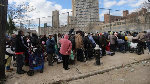 People wait on line to collect food and water at a distribution point in Coney Island in the wake of Hurricane Sandy on November 3, 2012. Mario Tama/Getty Images