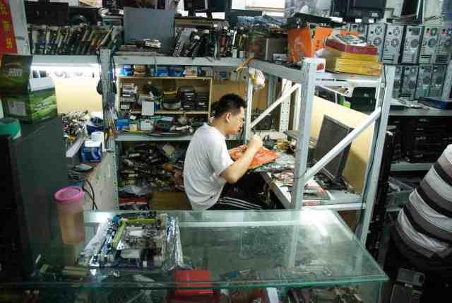 Repair technician at work. Beijing, China 2013