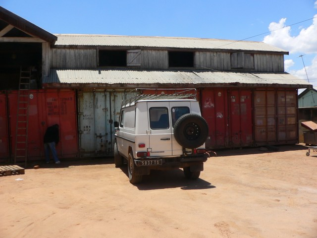 """Figure 2. The SALFA storage facility on the outskirts of Antananarivo, composed of decommissioned shipping containers and known to Minneapolis volunteers as """"container city."""" Photo by the author."""