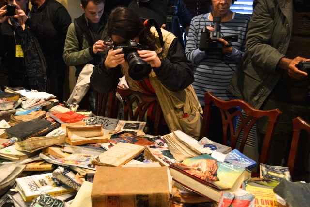 Press photographing damaged books at the conference announcing a lawsuit against the City of New York (Photo: M. Oman-Reagan)