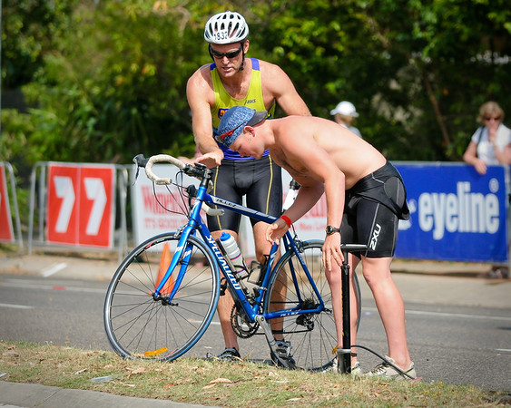 The guy helping had actually been in the race and joined his mates beside me just after finishing the cycle leg. The cyclist appreciated his help and shook his hand. - 2008 Noosa Triathlon, Noosa Heads, Sunshine Coast, Queensland, Australia. Photos by Des Thureson - http://disci.smugmug.com