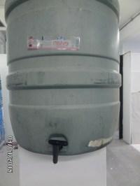 name - Omnia sunt communia {Water Stressed} materials - 100ltr water butt, Japlac enamel aerosol, acetate and toner dimensions - 2m dia. x 1m (plus plinth)
