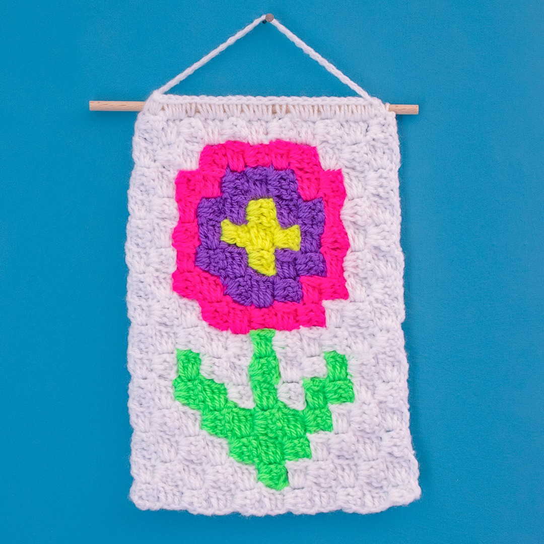 flower wall hanging made using corner to corner crochet technique