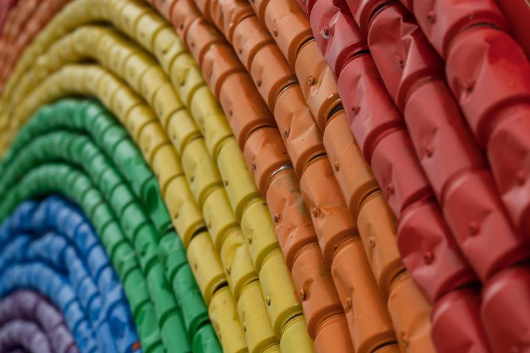 A rainbow is made up of painted beer cans
