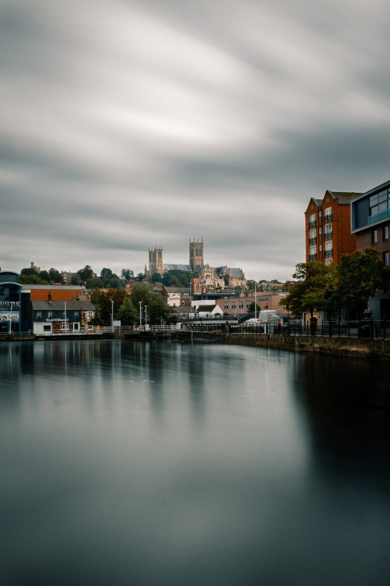 A lake in the foreground, lincoln cathedral stands in the background