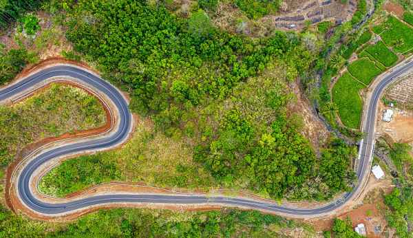 a zigzagging road in a mountain