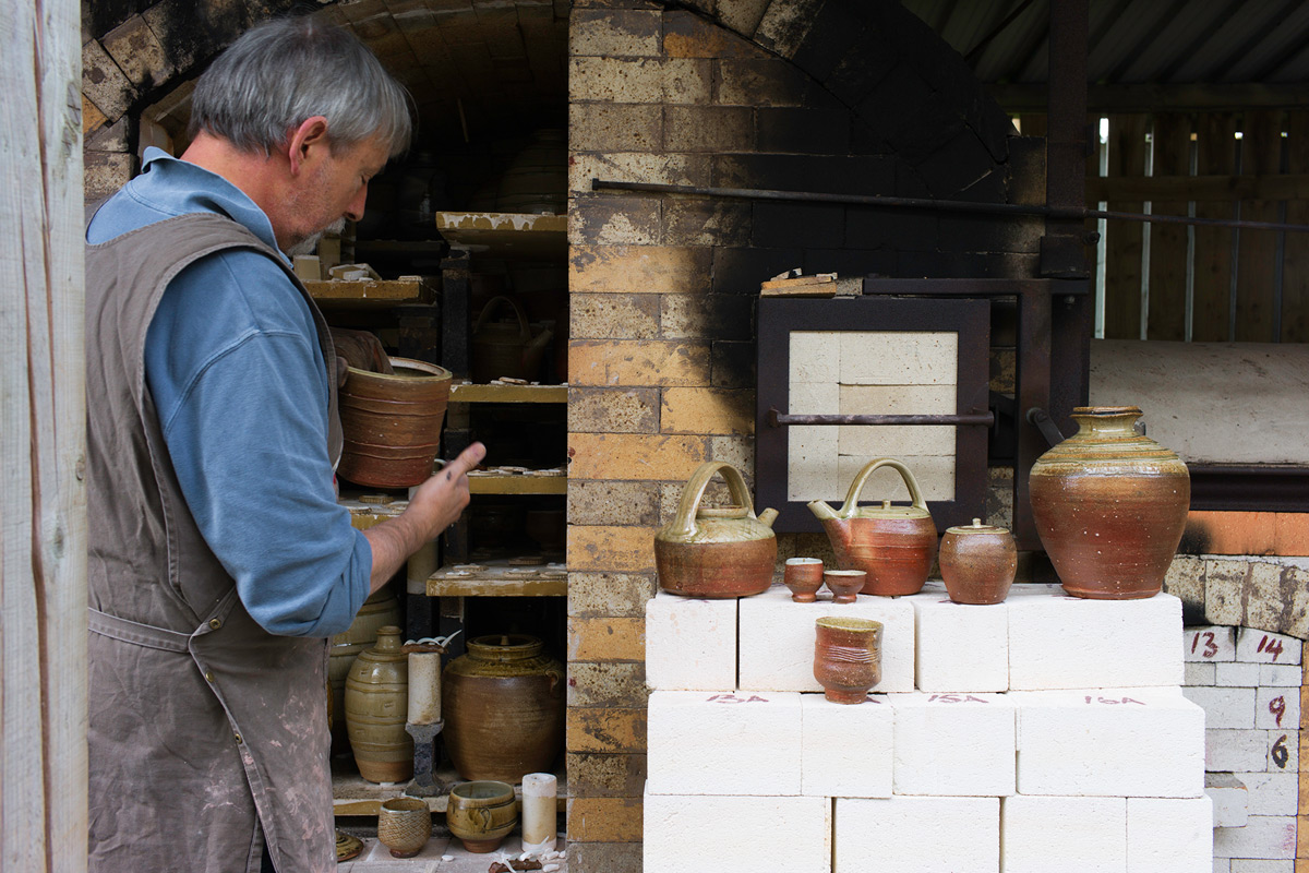Phil-Rogers-Firing-Wood-Kiln-Inspecting-Pots