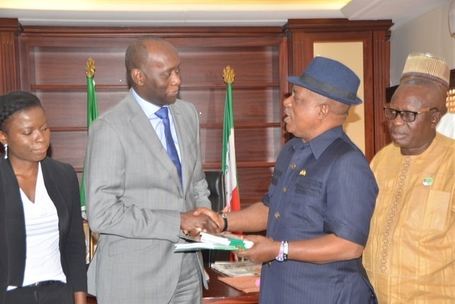 PDP National Chairman, Prince Uche Secondus presenting PDP Constitution and Manifesto to Mr. Kubwimana of the United Nation, as party tackles APC on restructuring