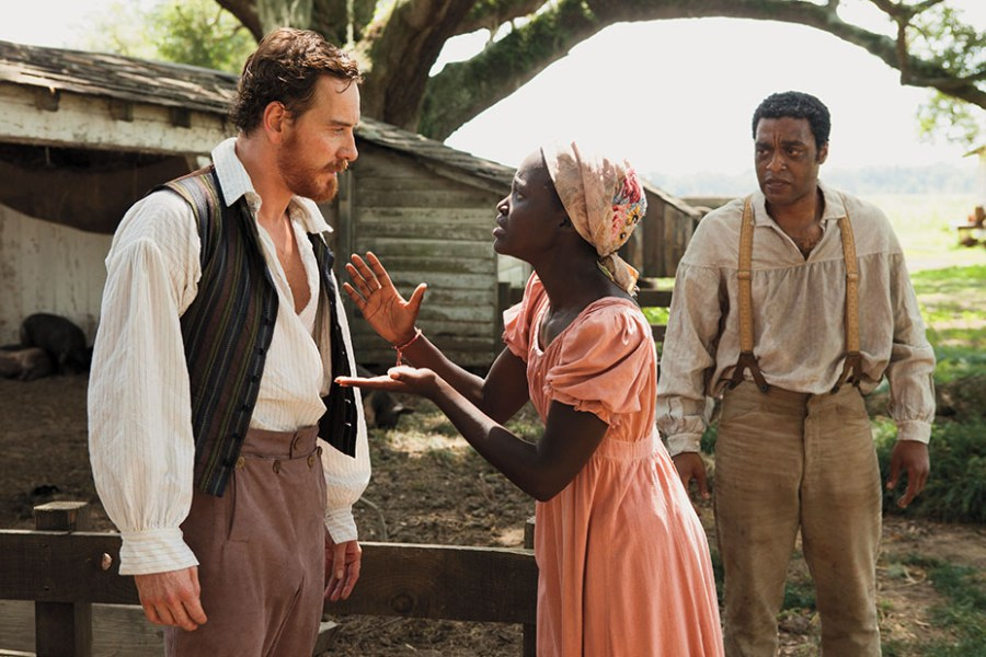 Courtesy of Francois Duhamel/Fox Searchlight Pictures With Michael Fassbender (left) and Chiwetel Ejiofor in 12 Years a Slave, her breakout role.
