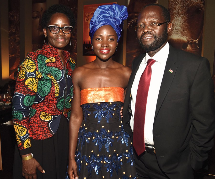 "TORONTO, ON - SEPTEMBER 10: (L-R) Dorothy Nyong'o, actress Lupita Nyong'o and Peter Anyang' Nyong'o at the world premiere of Disney's ""Queen of Katwe"" at Roy Thompson Hall as part of the 2016 Toronto Film Festival where the cast, filmmakers and real life stars received a standing ovation. The film, starring David Oyelowo, Oscar winner Lupita Nyong'o and newcomer Madina Nalwanga, is directed by Mira Nair and opens in U.S. Theaters September 23, 2017. (Photo by Alberto E. Rodriguez/Getty Images for Disney )"