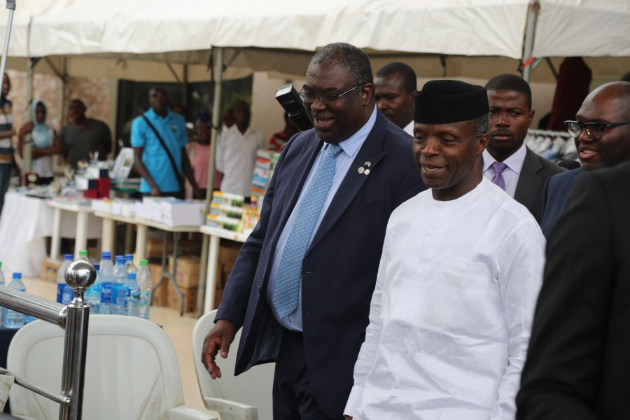 Vice President Yemi Osinbajo (in white) with the Executive Chairman of FIRS, Tunde Fowler at the opening of 20th CITN Conference at the NAF Center, recently in Abuja. Photo/FIRS