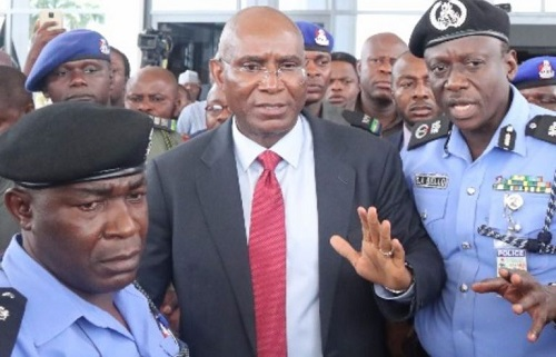 Scuffle with the senate: Omo-Agege (middle) flanked by the Police