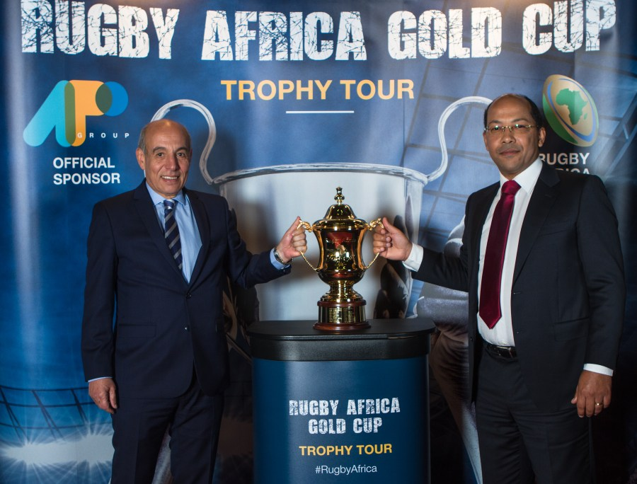 BRUSSELS, BELGIUM - MAY 8: Abdelaziz Bougja; Chairman of World Rugby's African association and Nicolas Pompigne-Mognard; Founder & CEO of APO group unveiling the new Rugby Africa Gold Cup's perpetual trophy during the 81st AIPS congress at Le Plaza Hotel on May 8, 2018 in Brussels, Belgium. (Photo by Jorge Luis Alvarez Pupo/Getty Images for APO Group)