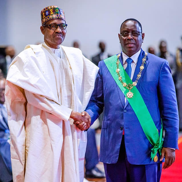 President Macky Sall of Senegal and Muhammadu Buhari of Nigeria (L)