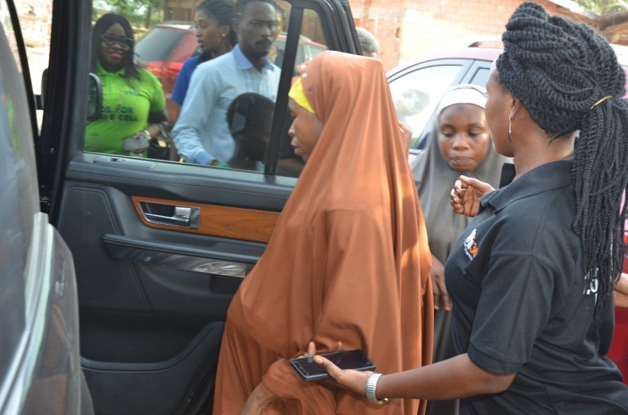 A pregnant woman goes into labour at the venue of Jiwa free medical outreach. She is being led into a waiting car to take her to Kubwa General Hospital for proper attention by Dagomo and ANPA team