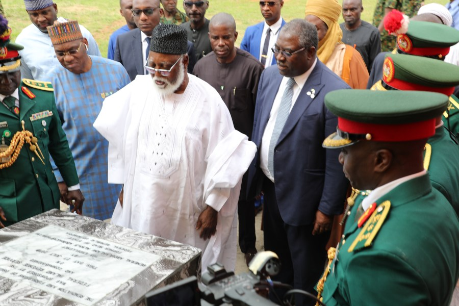 Former Head of State, Abdussalami Abubakar unveiling the commemorative stone plaque of the renovated hall