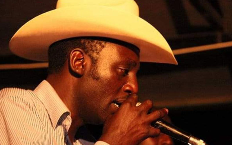 John De'Mathew, famous for cowboy hat, reportedly released more than 50 albums