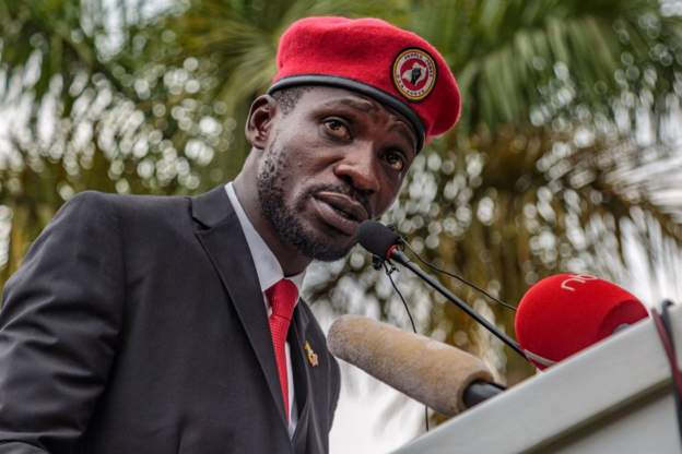 "Bobi Wine and his supporters wear a red beret as a ""symbol of resistance"""