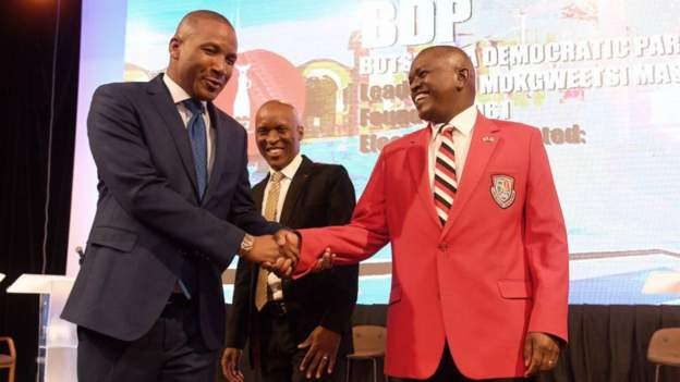 Masisi (R) has reversed the policies of his predecessor who now supports opposition candidate Duma Boko (L). Credit/BBC