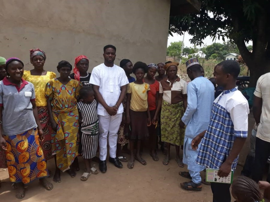 Executive Director, EHIGCW, Chinedu Okoronkwo (in white) with beneficiaries of the outreach during the NGO's sensitization exercise on education of the girl-child in Tafa Local Government Area of Niger State in February, 2019.