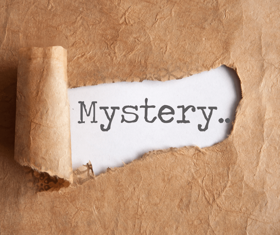 Brown paper torn to reveal the word Mystery