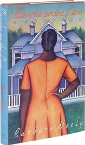 A house with white picket porch and an African American woman facing it. We only see the backside of her. She is wearing an orange short sleeved dress with her hair in a bun.