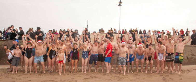 A big wave from the brave swimmers as they line up for their Xmas swim in Bundoran on Xmas Day. Photo:philipmulliganphotography.com
